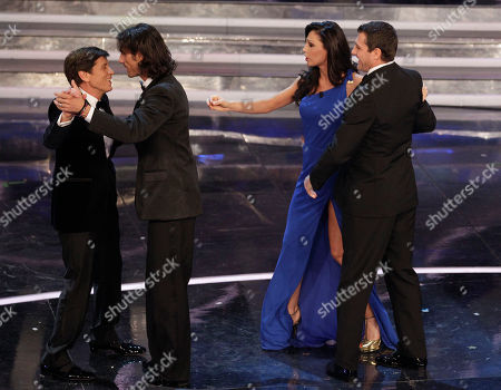 Italian show host Gianni Morandi, left, dances with Italian former soccer forward Marco Del Vecchio while Italian singer Anna Tatangelo dances with former Italia soccer forward Christian Vieri during the 62nd edition of the Sanremo Song Festival, in Sanremo, Italy