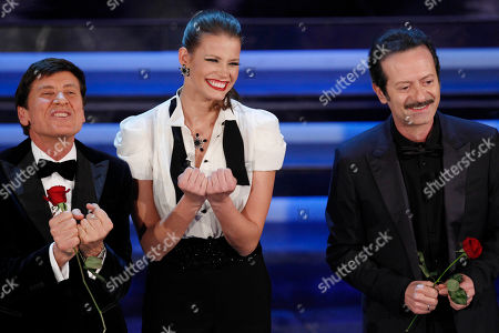 From left, Italian show host Gianni Morandi, Czech Republic model Ivana Mrazova and Italian actor Rocco Papaleo perform during the 62nd edition of the Sanremo Song Festival, in Sanremo, Italy