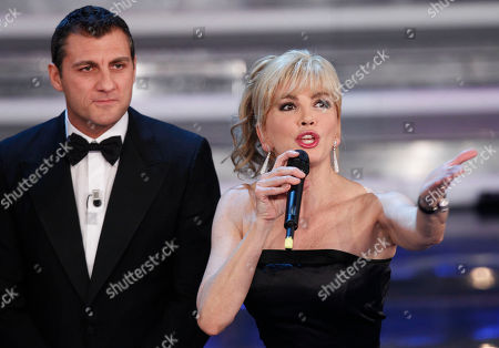 Italian showgirl Milly Carlucci and former soccer player Christian Vieri performs during the 62nd edition of the Sanremo Song Festival, in Sanremo, Italy