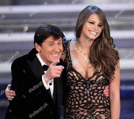 Italian show host Gianni Morandi and Czech Republic model Ivana Mrazova perform during the 62nd edition of the Sanremo Song Festival, in Sanremo, Italy