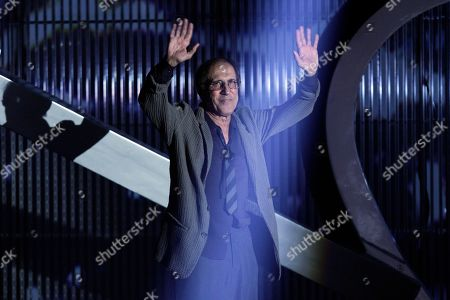 Italian singer Adriano Celentano waves to his fans during the 62nd edition of the Sanremo Song Festival, in Sanremo, Italy