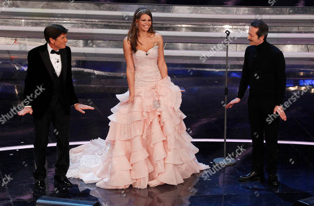 Czech Republic model Ivana Mrazova, center, Italian show host Gianni Morandi, left, and Italian actor Rocco Papaleo perform during the 62nd edition of the Sanremo Song Festival, in Sanremo, Italy