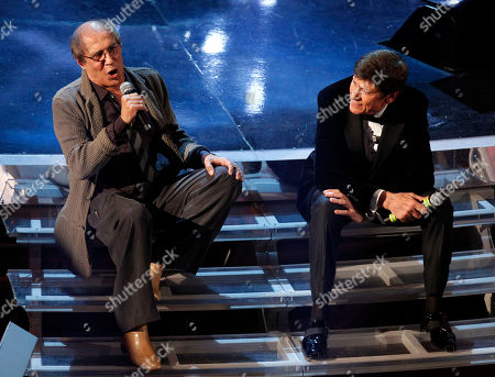 Stock Picture of Italian singer Adriano Celentano, left, performs with Italian show host Gianni Morandi during the 62nd edition of the Sanremo Song Festival, in Sanremo, Italy