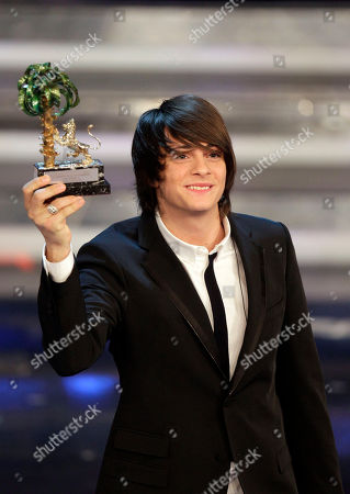 Italian singer Alessandro Casillo holds the trophy after winning the Sanremo youth section during the 62nd edition of the Sanremo Song Festival, in Sanremo, Italy
