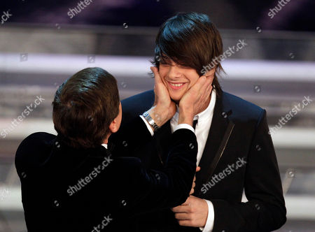 Italian singer Alessandro Casillo is congratulated by Italian show host Gianni Morandi after winning the Sanremo youth section during the 62nd edition of the Sanremo Song Festival, in Sanremo, Italy