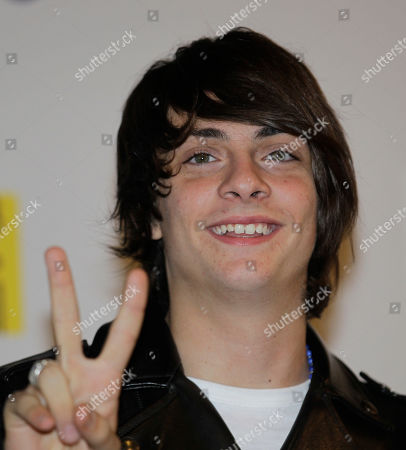 Italian singer Alessandro Casillo gestures as he poses prior to a press conference at the 62nd edition of the Sanremo Song Festival, in Sanremo, Italy, . Casillo won the Sanremo youth section prize