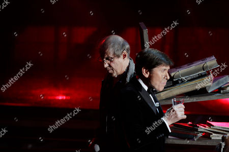 Italian singer Adriano Celentano, left, performs with Italian show host Gianni Morandi during the 62nd edition of the Sanremo Song Festival, in Sanremo, Italy