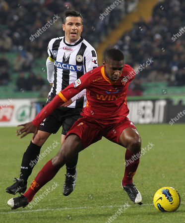 Stock Photo of AS Roma's Juan Silveira Dos Santos, right, of Brazil, and Udinese's Antonio Di Natale, challenge for the ball during the Serie A soccer match between Udinese and AS Roma, at the Udine Friuli stadium, Italy