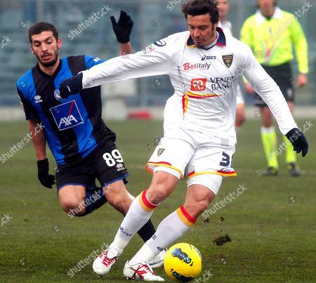 Massimo Oddo, Carlos Emilio Carmona Lecce's Massimo Oddo, right, is chased by Atalanta's Carlos Emilio Carmona, of Chile, during a Serie A soccer match in Bergamo, Italy