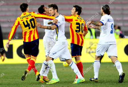 Chievo's Cyril Thereau, second from left, faces Lecce's Nenad Tomovic as Lecce's Massimo Oddo, second from right, faces Chievo's Rinaldo Cruzado during a Serie A soccer match at the Via del Mare stadium in Lecce, Italy