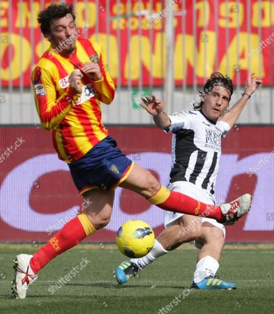 Lecce defender Massimo Oddo, left, and Siena defender Cristiano Del Grosso vie for the ball during a Serie A soccer match between Lecce and Siena, at the Via del Mare stadium in Lecce, Italy