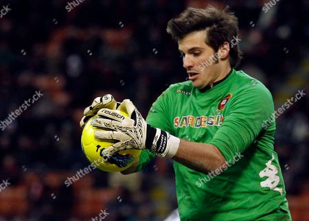 Cagliari goalkeeper Michael Agazzi stops a ball during a Serie A soccer match between AC Milan and Cagliari, at the San Siro stadium in Milan, Italy, Sunday, Jan.29, 2012
