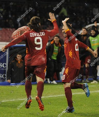 AS Roma players Pablo Osvaldo and Simone Perrotta celebrate Osvaldo's goal during a Serie A soccer match between Napoli and AS Roma, at Naples' San Paolo stadium, southern Italy, . AS Roma won 3-1
