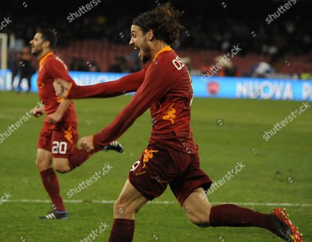 Roma's forward Pablo Osvaldo celebrates after scoring during a Serie A soccer match between Napoli and Roma, at Naples' San Paolo stadium, southern Italy, . At left is Simone Perrotta. AS Roma won 3-1