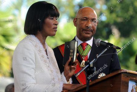 Portia Simpson Miller, Patrick Allen Jamaica's Prime Minister Portia Simpson Miller, left, holding a Bible in her left hand, takes the oath of office in the presence of Governor General Patrick Allen at King's House in Kingston, Jamaica, . Simpson Miller was sworn in for the second time as Jamaica's prime minister, pledging to ease the island's deep poverty, boost the chronically sputtering economy, heal political divisions and sever colonial-era links with Britain