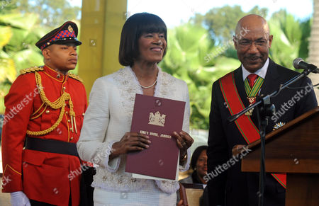 Portia Simpson Miller, Patrick Allen Jamaica's Prime Minister Portia Simpson Miller, center, smiles after being sworn in by Governor General Patrick Allen, right, at King's House in Kingston, Jamaica, . Simpson Miller was sworn in for the second time as Jamaica's prime minister, pledging to ease the island's deep poverty, boost the chronically sputtering economy, heal political divisions and sever colonial-era links with Britain