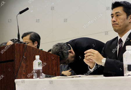 "Toshio Nishizawa, Goshi Hosono Tokyo Electric Power Co. President Toshio Nishizawa, center, bows as Japan's Nuclear Crisis Minister Goshi Hosono looks on during a press conference at the headquarters of TEPCO, the operator of the tsunami-damaged Fukushima Dai-ichi nuclear power plant, in Tokyo, shortly after Japan's prime minister announced that the nuclear plant has achieved a stable state of ""cold shutdown,"" a crucial step toward the eventual lifting of evacuation orders and closing of the plant. Nishizawa apologized for the accident, and vowed to further stabilize the plant and reduce its radiation release until the operator finally put it to a close"