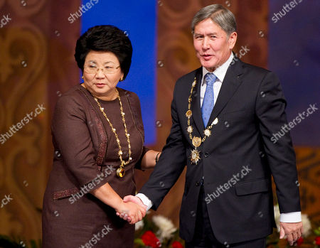 Stock Photo of Almazbek Atambayev, Roza Otunbayeva New Kyrgyz president Almazbek Atambayev, right, and his predecessor Roza Otunbayeva shake hands after an inauguration ceremony in Bishkek, Kyrgyzstan, . Kyrgyzstan inaugurated a new president Thursday in the first peaceful transition of power in the former Soviet Central Asian nation. Speaking after his swearing-in, Almazbek Atambayev sounded a note of ethnic harmony and called on all political camps to unite to assure Kyrgyzstan's future prosperity