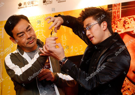 "Lau Ching Wan, Zlwin Chew Magician Zlwin Chew, right, performs a magic trick beside Hong Kong actor Lau Ching Wan during a press conference to promote Lau's latest movie ""The Great Magician"" in Kuala Lumpur, Malaysia"