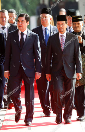 Gurbanguly Berdimuhamedov, Mizan Zainal Abidin, Najib Razak Turkmenistan's President Gurbanguly Berdimuhamedov, front left, accompanied by Malaysia's King Sultan Mizan Zainal Abidin, front right, and Prime Minister Najib Razak, behind center, walks after inspecting a guard of honor during a welcoming ceremony at parliament house in Kuala Lumpur, Malaysia