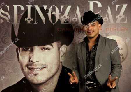 Espinoza Paz Mexico's singer Espinoza Paz poses for photographers at a press conference in Mexico City, . Paz is promoting his free concert in Acapulco 28 Dec. 28