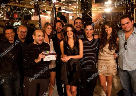 "Actors pose for a photo during the filming of the movie ""Fachon Models"" in Mexico City, . The comedy movie ""Fachon Models,"" directed by Rafael Montero, tells the story of Ulysses, an infomercial actor who secretly dreams of success in the theater. His life takes a turn when he reunites with Carolina, his childhood sweetheart, a beautiful and successful political adviser. Ulysses is played by Euguenio Bartilotti, third from right. Carolina is played by Adriana Louvier, fourth from right. Claudio Mancera, the king of infomercials, third from left, is played by Edgar Vivar, the beloved ""Mr. Barriga"" of ""El Chavo,"" who makes a cameo. Film Director Rafael Moreno is second from left"
