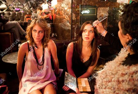"Adriana Louvier Mexican actress Adriana Louvier, right, who plays the character Carolina, sits as make-up is applied to her face on the set of the filming of the movie ""Fachon Models"" in Mexico City, . The comedy movie ""Fachon Models,"" directed by Rafael Montero, tells the story of Ulysses, an infomercial actor who secretly dreams of success in the theater. His life takes a turn when he reunites with Carolina, his childhood sweetheart, a beautiful and successful political adviser. The movie will premier in mid-2012"