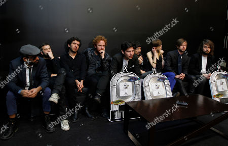 """Members of the Mexican rock band Zoe, from left to right, Jesus Baez, Angel Mosqueda, Yamil Rezc, guest, Andrez Sanchez, guest, Segio Acosta, Leon Larregui, Denise Gutierrez, guest, Chetes, and guest Rodrigo Guardiola, pose for photographers during a press conference after being awarded with the triple platinum record for his album """"Musica de Fondo: MTV Unplugged"""" in Mexico City"""