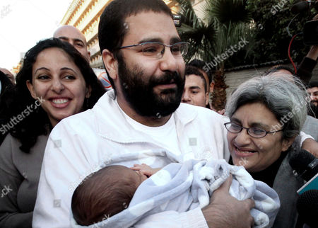 Alaa Abdel-Fattah Egyptian prominent blogger Alaa Abdel-Fattah, center, hugs his recently born son, Khaled, his mother Laila Soueif, and his sister Ahdaf Soueif, left, after his release, in Cairo, Egypt. A court has convicted Abdel-Fattah for demonstrating without permit and assaulting a policeman, sentencing him to 15 years in prison