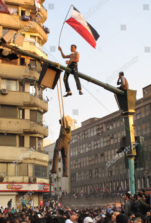 An Egyptian protester hangs an effigy representing Egypt's military ruler, Field Marshal Mohamed Hussein Tantawi, the head of SCAF, The Supreme Council of the Armed Forces, at Tahrir Square in Cairo, Egypt, . Egypt's ruling military moved up the date for transferring power to a civilian government to July next year and consulted Tuesday with political parties on forming a new Cabinet. But the major concessions were immediately rejected by tens of thousands of protesters in Cairo's iconic Tahrir Square threatening a 'second revolution