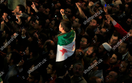 Ismail Haniyeh A boy wears a Syrian flag and others chant anti Israeli slogans as Gaza's Hamas Prime Minister Ismail Haniyeh gives a speech after Friday prayer at Al Azhar mosque in Cairo, Egypt