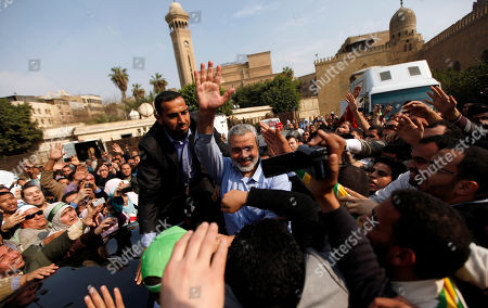 Ismail Haniyeh Gaza's Hamas Prime Minister Ismail Haniyeh waves to his supporters after prayers at Al Azhar mosque in Cairo, Egypt