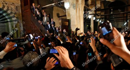 Ismail Haniyeh People take photographs with their cell phones as Gaza's Hamas Prime Minister Ismail Haniyeh gives a speech after Friday prayer at Al Azhar mosque in Cairo, Egypt