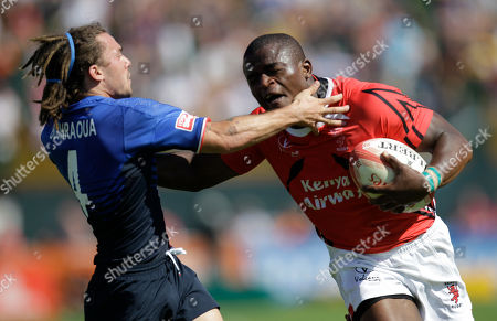 Newsmaker Names Kenya's Willy Ambaka, right, and Terry Bouhraoua from France in action during the first day of the Dubai Rugby Sevens, in Dubai, United Arab Emirates