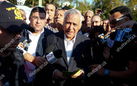 """Moshe Katsav Former Israeli President Moshe Katsav speaks to journalists as he leaves his house in Kiryat Malachi, central Israel, . Former Israeli President Moshe Katsav defiantly accused the state of Israel of """"executing"""" an innocent man, just before he drove off Wednesday to a prison in central Israel to start serving a seven-year sentence for rape"""