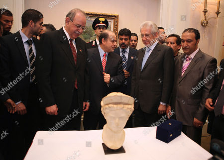 Abdurrahim el-Keib, Mario Monti Libyan Prime Minister Abdurrahim el-Keib, second left and and Italian Prime Minister Mario Monti, second right, appear with an artifact returned by Italy to Libya, known as the Head Domitilla, which was stolen from Sabratha, Libya in 1990, during Monti's visit to Tripoli, Libya
