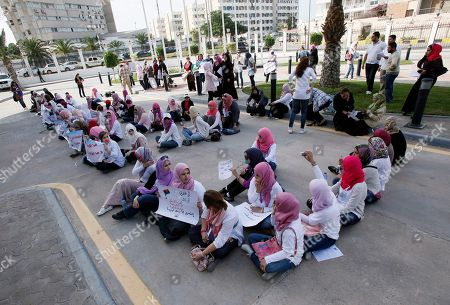 Libyan women gather in Tripoli, Libya to pressure the new government to do more to help women raped during the country's civil war, . Some 60 women sang and chanted slogans outside the office of Prime Minister Abdurrahim el-Keib on Saturday. They said the government, in its focus to help wounded soldiers, is failing to help women sexually assaulted by Moammar Gadhafi's forces during the war
