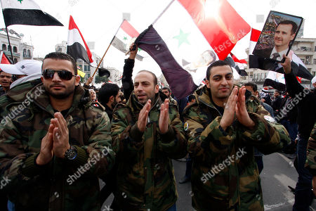 Stock Photo of Syrian soldiers chant slogans during a pro-regime rally in Damascus, Syria, .The rebel Free Syrian Army said Friday it has stopped its offensive against government targets during a month-long mission by Arab Legue monitors, saying it wants to expose how the regime is killing peaceful protesters