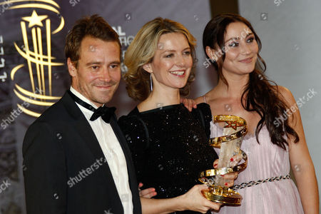 """Stock Picture of Frederikke Aspšck, Daniel Dencik, Stephanie Leon From left to right Screenwriter Daniel Dencik, Danish director Frederikke Aspock and actress Stephanie Leon pose after winning the Golden Star award for the film """"Out of Bounds"""" during the closing ceremony of the 11th Marrakech International Film Festival in Marrakech, Morocco"""