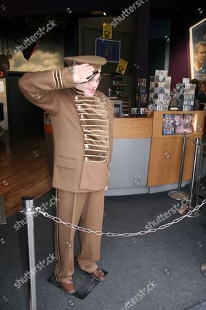 """Wax figure in entrance of """"Madame Tussauds"""" waxworks in Amsterdam, Holland, Netherlands"""