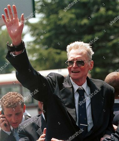 Stock Photo of 5 Leka Zog I, son of Albania's exiled late King Ahmet Zog waving to wellwishers at Tirana International Airport in Albania. A spokeswoman for Albania's royal family says that King Leka I Zogu, died