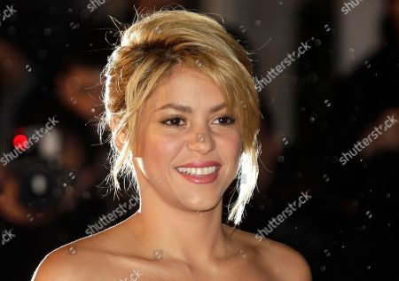 Shakira Colombian singer Shakira arriving at the Cannes festival palace, to take part in the NRJ Music awards ceremony, in Cannes, southeastern France. A spokesman for the 35-year-old Columbian singer says Shakira Mebarak and 25-year-old soccer star Gerard Pique of FC Barcelona welcomed son Milan Pique Mebarak, at 9:36 p.m. in Barcelona, Spain
