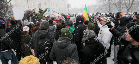 People smoke marijuana in front of parliament as part of a campaign to liberalize the country's drug laws. Janusz Palikot, the head of the left-wing party Palikot's Movement, took a few puffs from a joint under falling snow in Warsaw, Poland, . to make their point. Activists at the gathering said they want the country's laws changed to decriminalize the possession and consumption marijuana