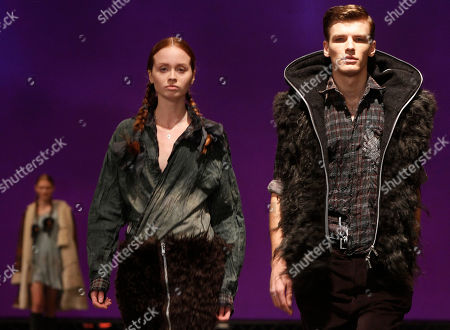 Stock Image of A models presents a creation from Polish fashion designer's Robert Kupisz new collection in Warsaw, Poland