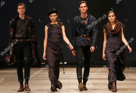A models presents a creation from Polish fashion designer's Robert Kupisz new collection in Warsaw, Poland