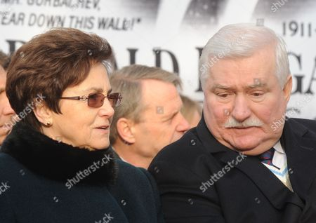 """Lech Walesa, Danuta Walesa Former Polish President Lech Walesa and wife Danuta speak during an unveiling ceremony of a statue honoring the late U.S. president Ronald Reagan, in Warsaw, Poland, . In her memoirs """"Dreams and Secrets,"""" out this week, Danuta Walesa talks of her loneliness and the couple's eight children missing their father while Lech Walesa was devoting time as leader of the Solidarity freedom movement in the 1980s and president from 1990-1995"""