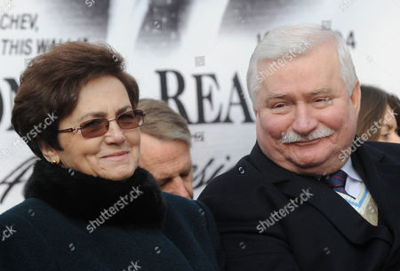 """Lech Walesa, Danuta Walesa Former Polish President Lech Walesa and wife Danuta smile during an unveiling ceremony of a statue honoring the late U.S. president Ronald Reagan, in Warsaw, Poland, . In her memoirs """"Dreams and Secrets,"""" out this week, Danuta Walesa talks of her loneliness and the couple's eight children missing their father while Lech Walesa was devoting time as leader of the Solidarity freedom movement in the 1980s and president from 1990-1995"""
