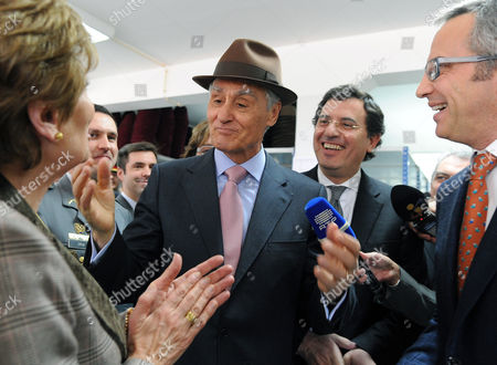 Stock Picture of Portugal's president Anibal Cavaco Silva, center, with his wife Maria, left, react after being presented with a hat by Ricardo Figueiredo, right, CEO of FEPSA hat factory in S. Joao da Madeira, Portugal, Debt burdens are rising fastest in European countries that have enacted the most draconian austerity programs. Portugal's unemployment rate hit a record 14 percent at the end of last year and the government imposed austerity measures to slash costs: Portugal cut pensions, reduced public servants' wages and raised taxes starting in 2010