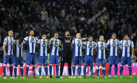 Stock Image of Maicon Roque, Djalma Campos, Rolando Fonseca, James Rodriguez, Fernando Reges, Helton Arruda, Nicolas Otamendi, Joao Moutinho, Fernando Belluschi, Alvaro Pereira, Givanildo Souza FC Porto's Maicon Roque, Djalma Campos, Rolando Fonseca, James Rodriguez, Fernando Reges, goalkeeper Helton Arruda, Nicolas Otamendi, Joao Moutinho, Fernando Belluschi, Alvaro Pereira and Givanildo 'Hulk' Souza, from left, pay a minute of respect to Cesaria Evora, a Cape Verdean singer who died at 70, prior to their game with Maritimo in a Portuguese League soccer match at the Dragao Stadium in Porto, Portugal, . Evora, who started singing as a teenager in bayside bars of Cape Verde in the 1950s and won a Grammy in 2003 after she took her African island music to stages across the world, died Saturday. She was also a fan of Portuguese soccer champion FC Porto