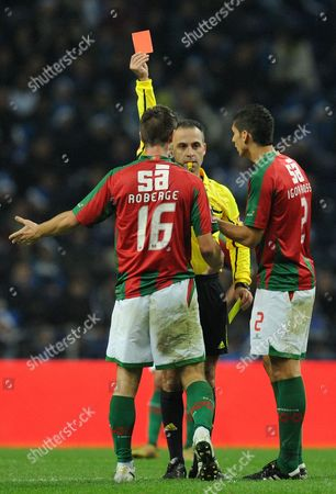 Maritimo's Valentin Roberge, left, from France receives a red card from referee Duarte Gomes in a Portuguese League soccer match with FC Porto at the Dragao Stadium in Porto, Portugal